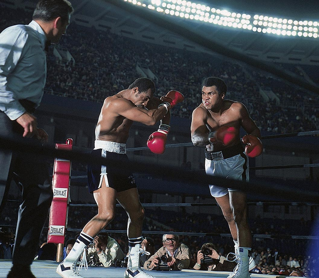 Norton takes a right hook during the heavyweight title fight against Ali. The bout, which Ali won by a unanimous, but controversial, decision, was the last boxing match at Yankee Stadium until 2010.