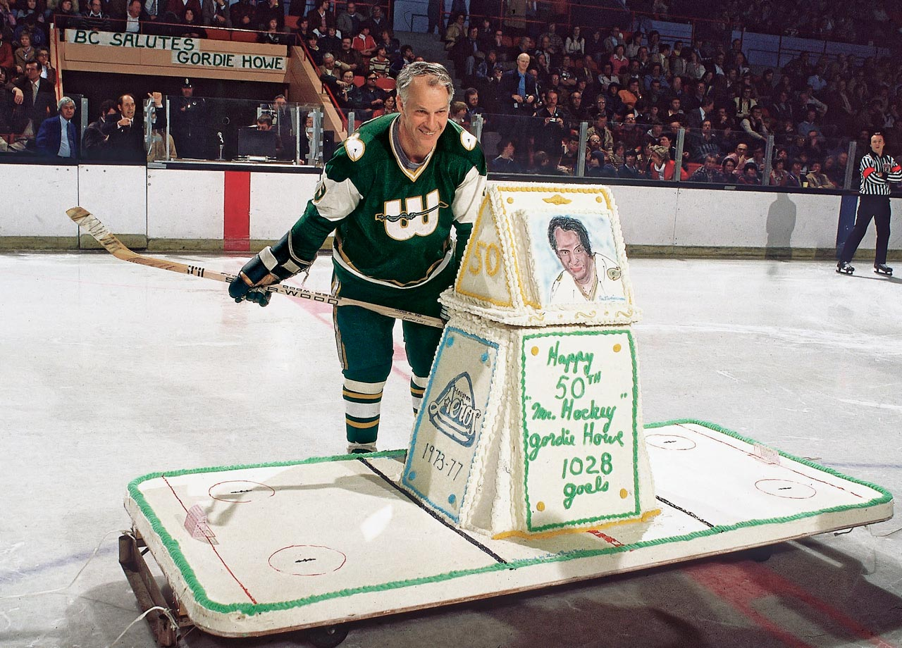Mr. Hockey admires his 50th birthday cake before a game against the Cincinnati Stingers. When Gordie Howe returned to the NHL the next year as the league absorbed the Whalers, he became the oldest player in NHL history, and he remains the only person to play in the league at age 50 or older.