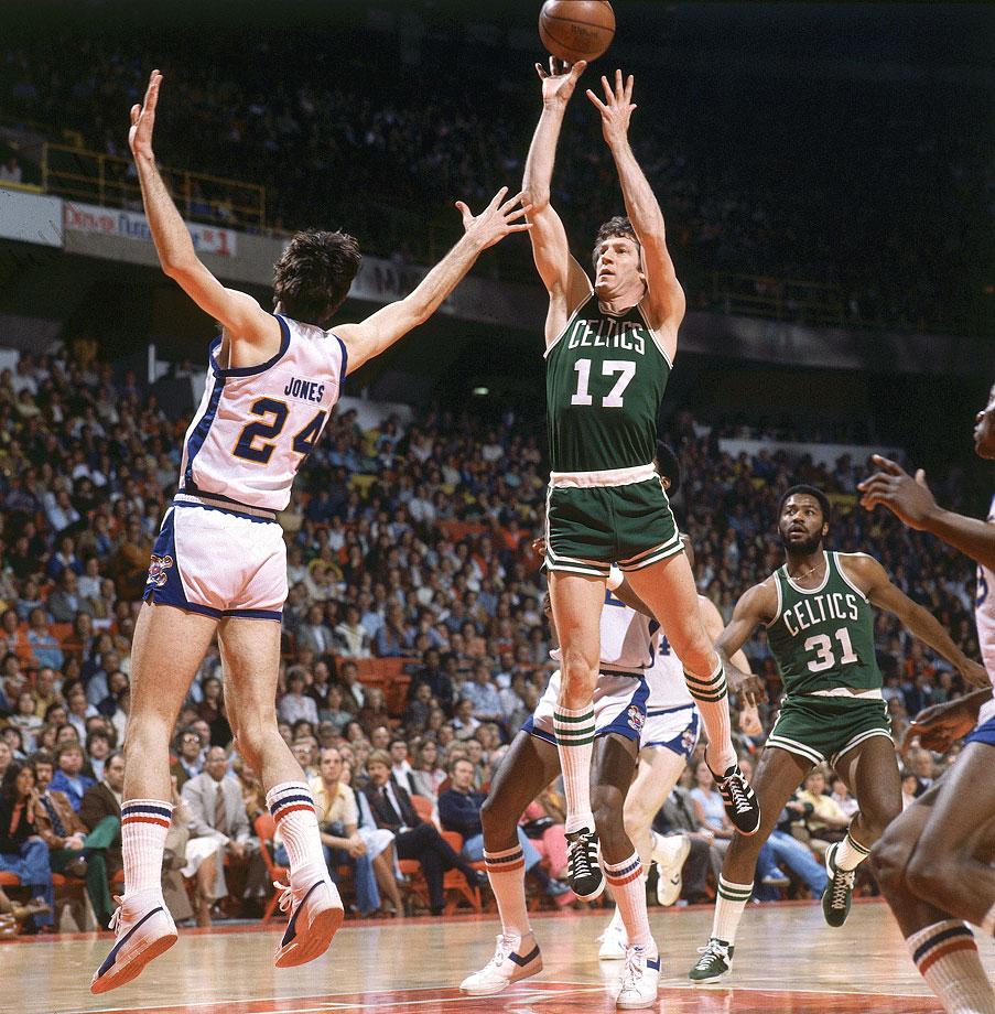 John Havlicek shoots over Bobby Jones during a Celtics game against the Denver Nuggets at McNichols Sports Arena.