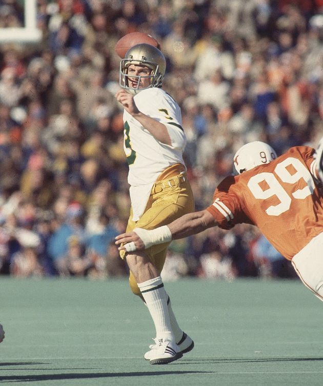 Notre Dame QB Joe Montana (3) making pass vs Texas Steve McMichael (99).
