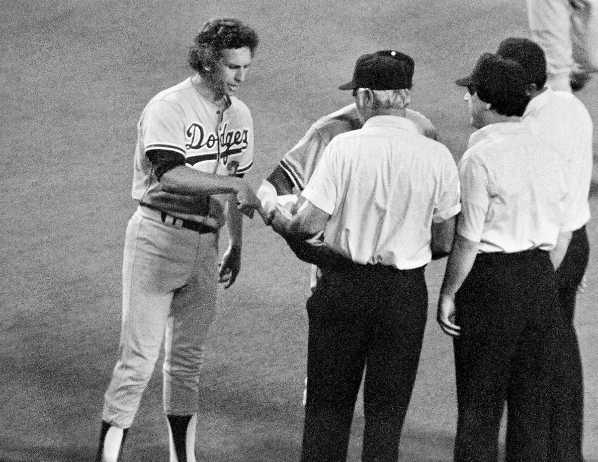 Dodgers pitcher Don Sutton was ejected from a game after it was discovered he was throwing a scuffed ball. He was originally ejected and suspended for 10 days, but later threatened to sue the National League and the issue went away.