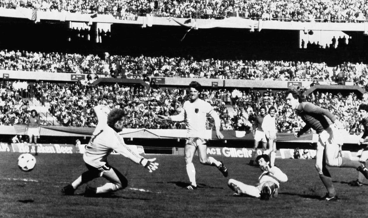 Dutchman Ernie Brandts turns the ball into his own goal past his goalkeeper, Piet Schrijvers, for an own goal during the Netherlands' second-round match with Italy in the 1978 World Cup.