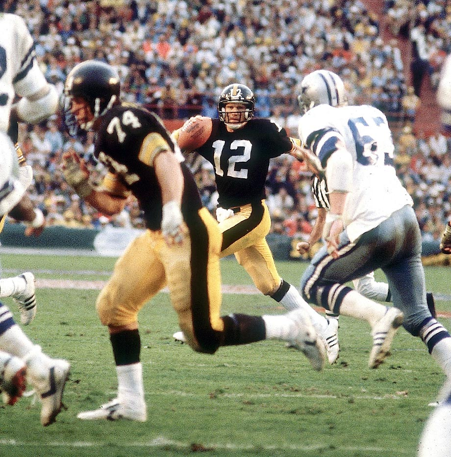 Pittsburgh Steelers quarterback Terry Bradshaw scrambles away from the Dallas Cowboys defense before tossing a touchdown pass to Rocky Bleier. Led by Bradshaw's 318 passing yards and four touchdowns, the Steelers won in a shootout, beating the Cowboys 35-31. Dallas was the first of only two teams (San Francisco, 2013) to score 30 or more points and lose a Super Bowl.