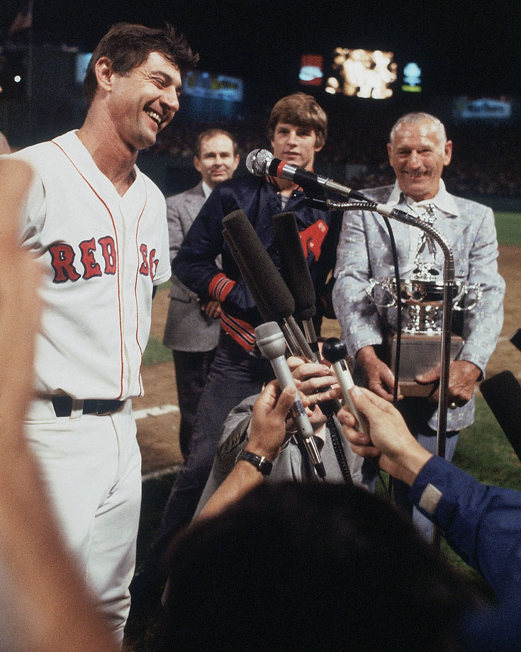Carl Yastrzemski talks with the media after getting his 3,000th career hit during a game against the New York Yankees on Sept. 12, 1979 at Fenway Park in Boston.