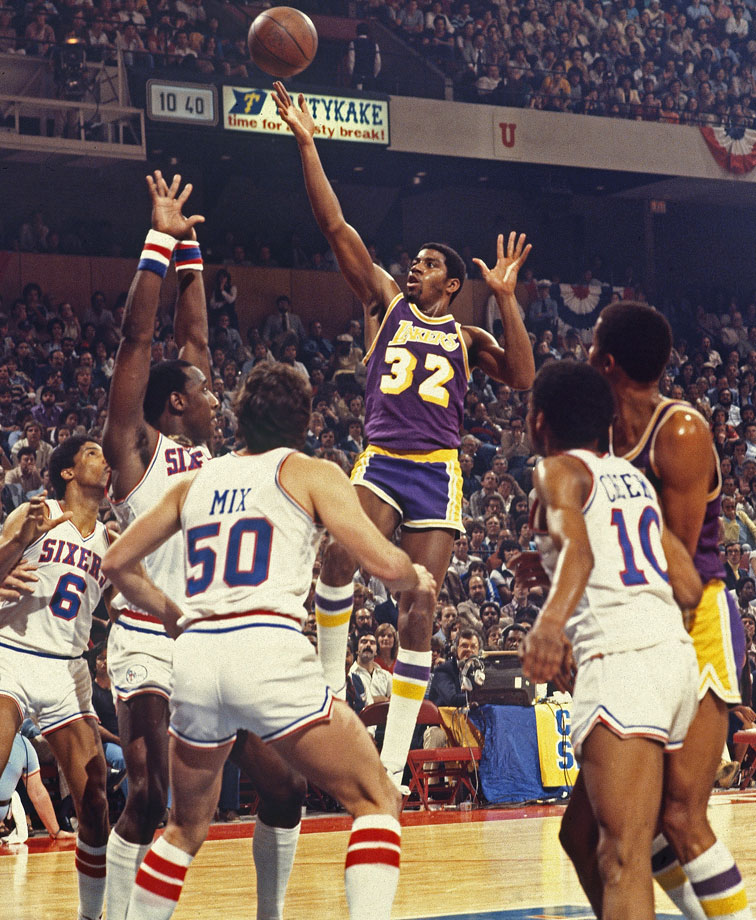 To offset Kareem Abdul-Jabbar's ankle injury, Magic Johnson moved to center and guided the undersized Lakers to a championship-clinching road win over the 76ers. The rookie Johnson scored 42 points and grabbed 15 boards.
