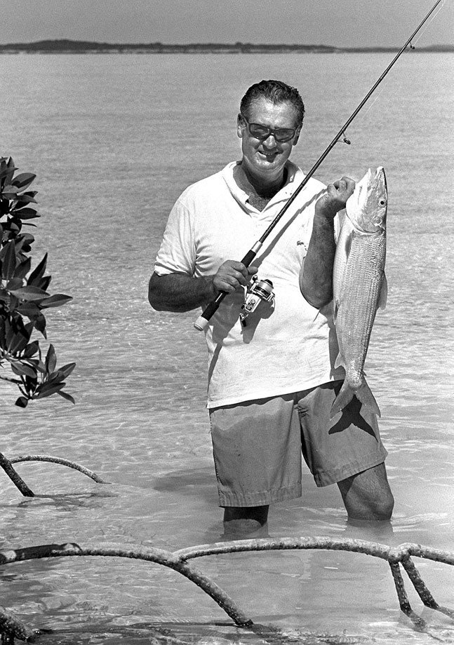 An expert fisherman, Ted Williams holds a 10 lb. bonefish in 1980.