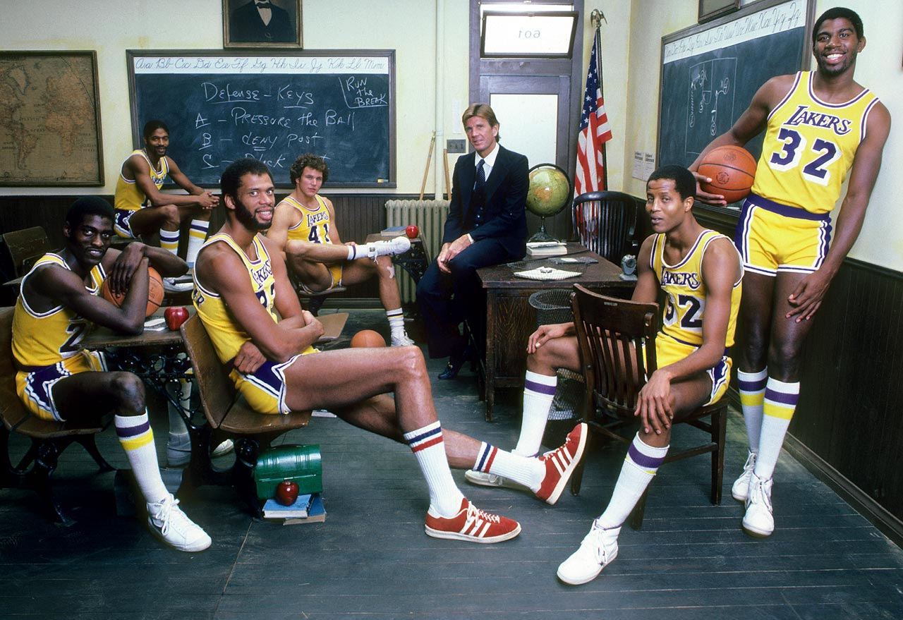 with (from left) Michael Cooper, Norm Nixon, Mitch Kupchak, Paul Westhead, Jamaal Wilkes and Magic Johnson