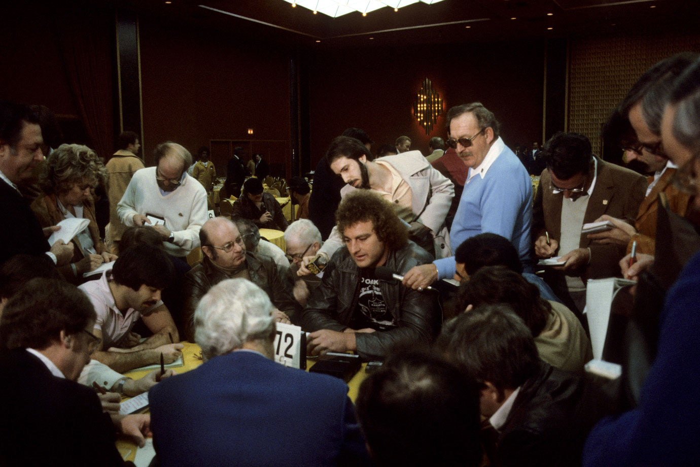 Reporters talk to Raiders defensive end John Matuszak at the New Orleans Airport Hilton in Kenner, La., before Super Bowl XV. Oakland defeated Philadelphia 27-10.
