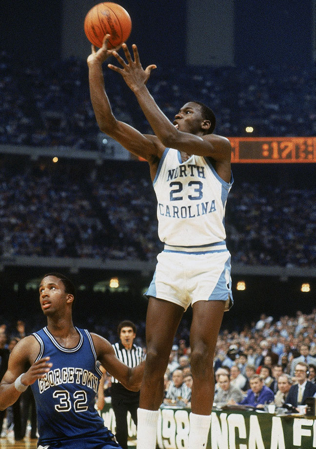 Michael Jordan hits the game-winning jumper to beat Georgetown in the 1982 NCAA Championship game. Jordan, ACC Freshman of the Year, propelled North Carolina to a national title by nailing a jumper with 17 seconds remaining, putting the Tar Heels up for good 63-62. Jordan had 16 points in the game.