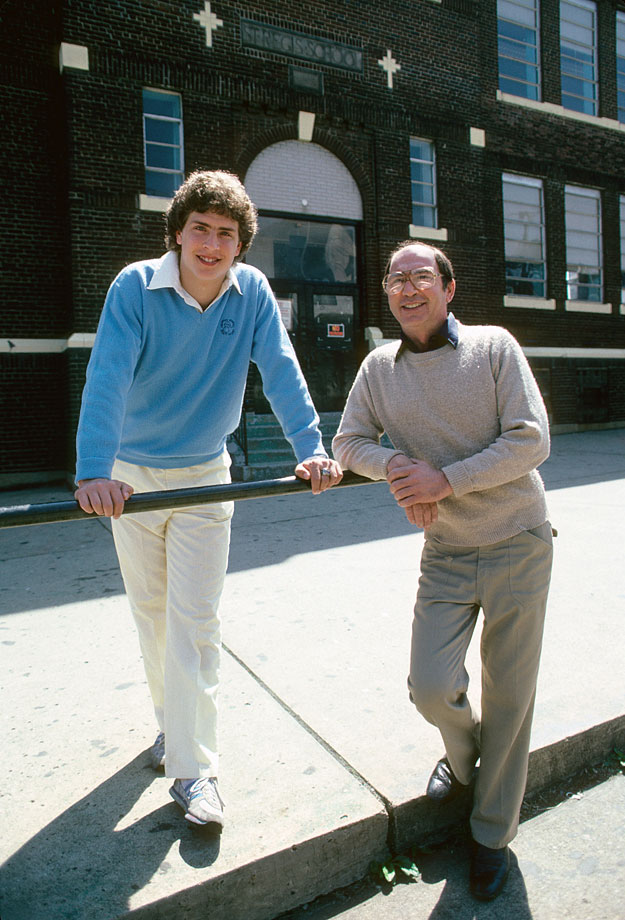 Dan Marino poses with his father Dan Sr. in front of his grade school, St. Regis School, in Pittsburgh on April 10, 1982.