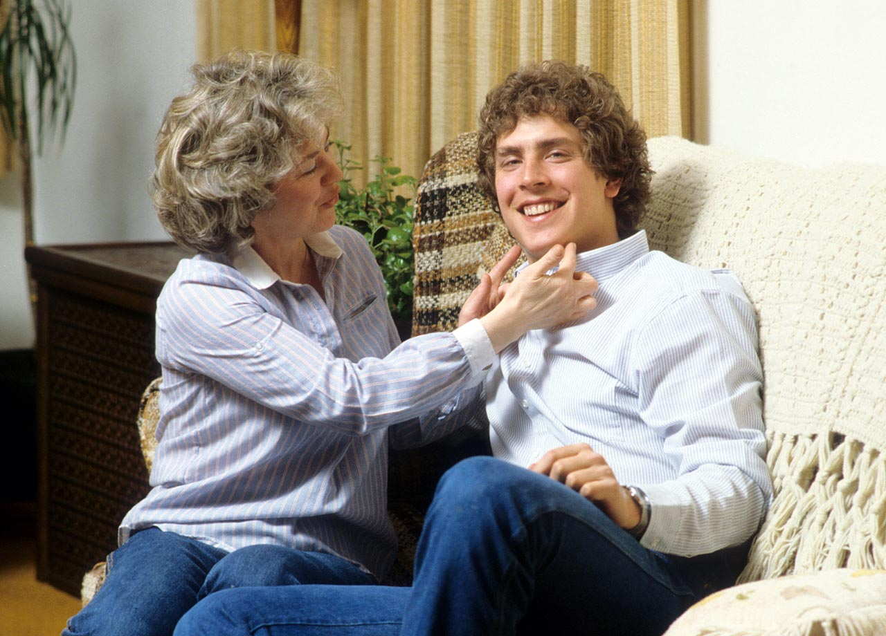Dan Marino smiles with his mother Veronica at their South Oakland house on Parkview Avenue in Pittsburgh on April 10, 1982.
