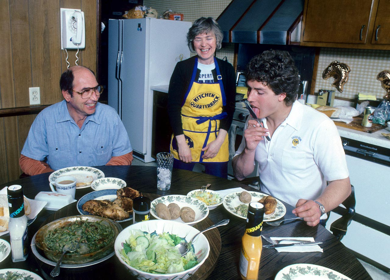 Dan Marino licks his knife while having dinner with his parents at their South Oakland house on Parkview Avenue in Pittsburgh on April 10, 1982.