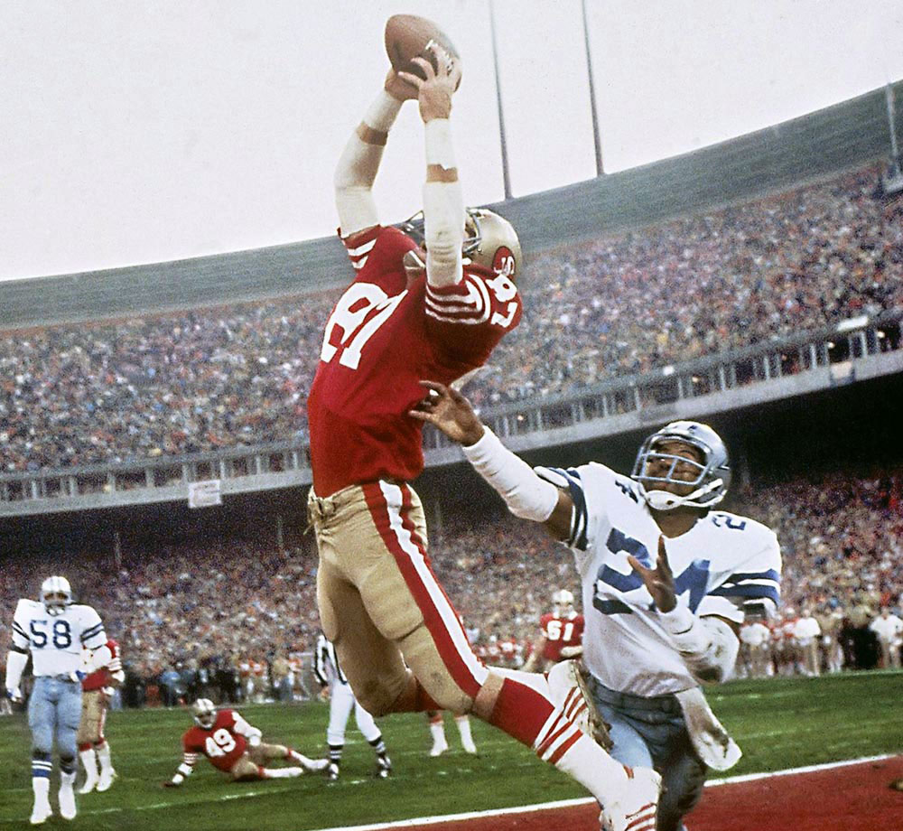 "One of the most famous plays in NFL history, Dwight Clark's leaping, fingertip touchdown grab of a Joe Montana pass—forever known as ""The Catch""—gave the 49ers a 28-27 lead over the Cowboys with just 51 seconds on the clock. San Francisco would go on to win the game and the Super Bowl."
