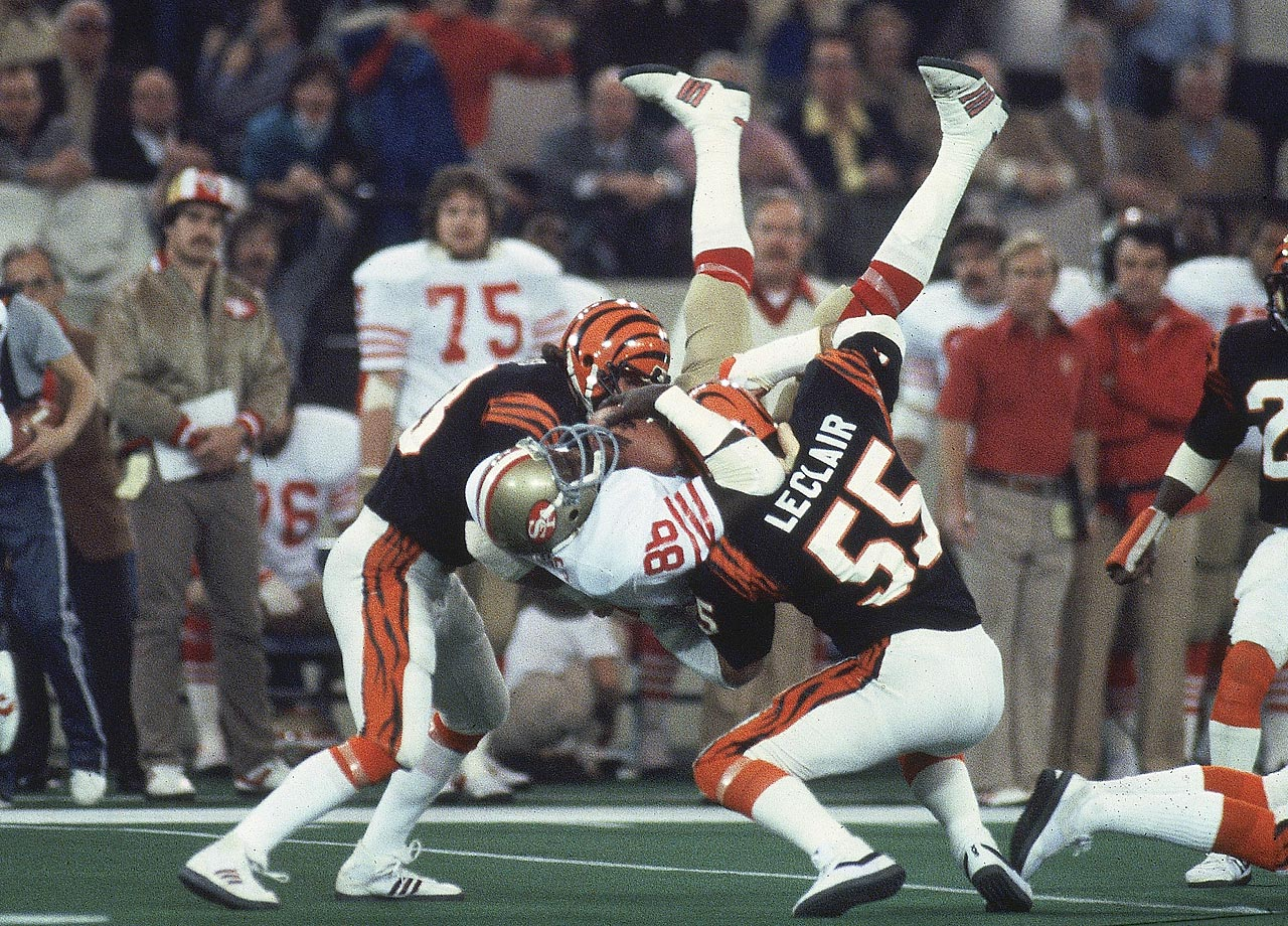 San Francisco 49ers tight end Charles Young hangs on to a pass while being sandwiched between linebacker Jim LeClair and another Cincinnati Bengals defender. Young's grab went for a gain of 14 yards and helped set up the 49ers' first score in their 26-21 victory.