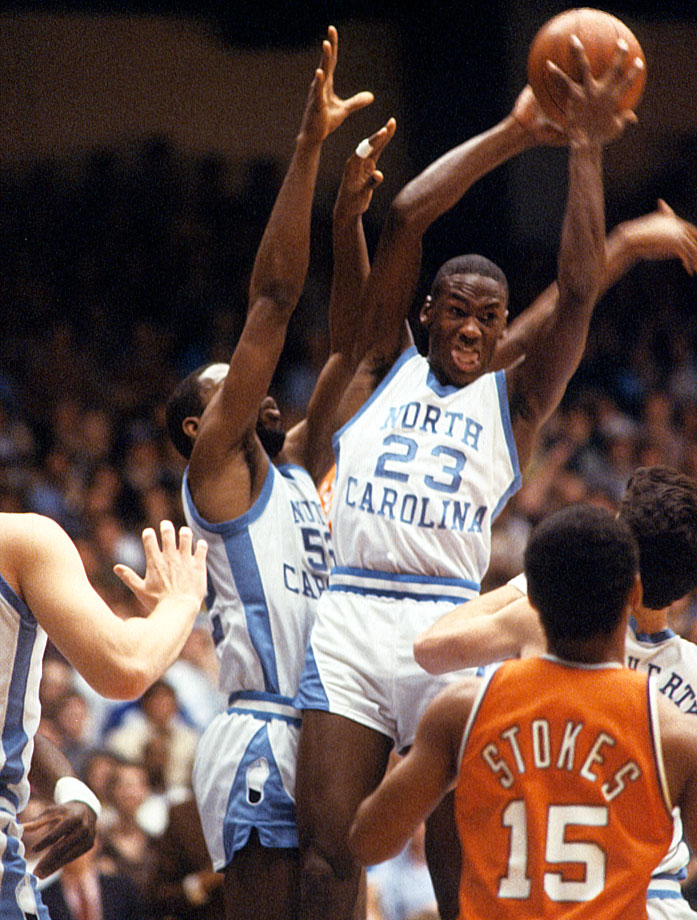 Michael Jordan pulls down a rebound in an ACC game against Virginia in January 1982. He scored 13.5 points per game that season as a freshman.