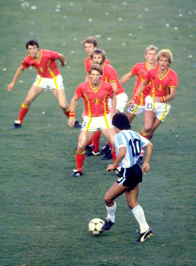 Diego Maradona, one of soccer's best World Cup performers ever, dribbles in between six Belgians on his way to scoring a coast-to-coast goal in the 1982 World Cup.  The goal is widely regarded as one of the best in soccer's history.