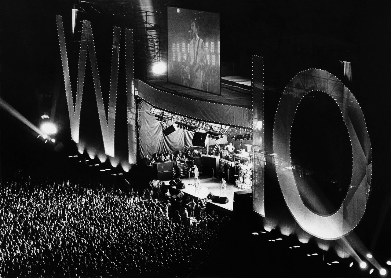 """One of the great double bills in New York music history featured a crowd of 50,000 watching the giants of the 1960s British rock playing their """"Farewell Tour,"""" and the vanguard of the British punk scene at their peak commercially. The Clash later released a popular album titled Live at Shea Stadium."""