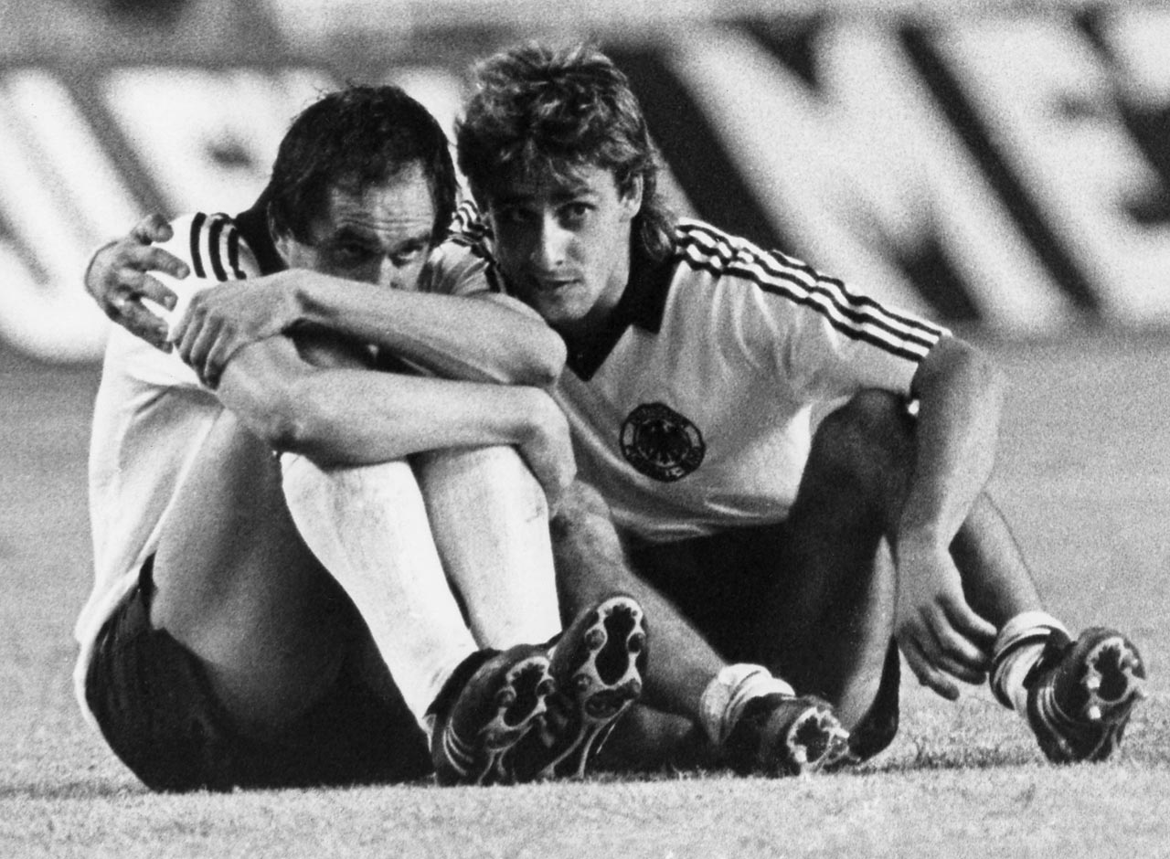 Uli Steilike curls up in a ball after missing the first penalty in a penalty shootout between West Germany and France (West Germany would eventually win despite Steilike's initial miss)