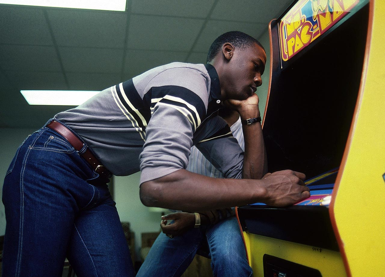 Michael Jordan plays Ms. Pac Man at North Carolina in November 1983. Already a first-team All-America from his sophomore season, Jordan topped that by winning the 1984 John Wooden Award as a junior before declaring for the NBA Draft.