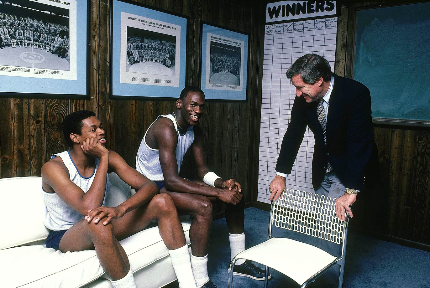 Michael Jordan and Sam Perkins sit on the couch in coach Dean Smith's office at North Carolina in November 1983. Smith won the first national championship of his Hall of Fame coaching career with Jordan and Perkins in 1982.