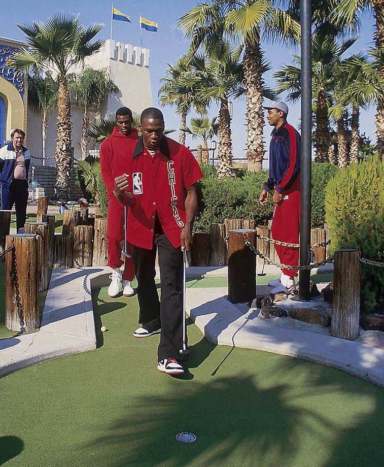 Rookie sensation Michael Jordan opts for some slightly smaller links in a round of miniature golf with the Bulls in Phoenix in 1984.