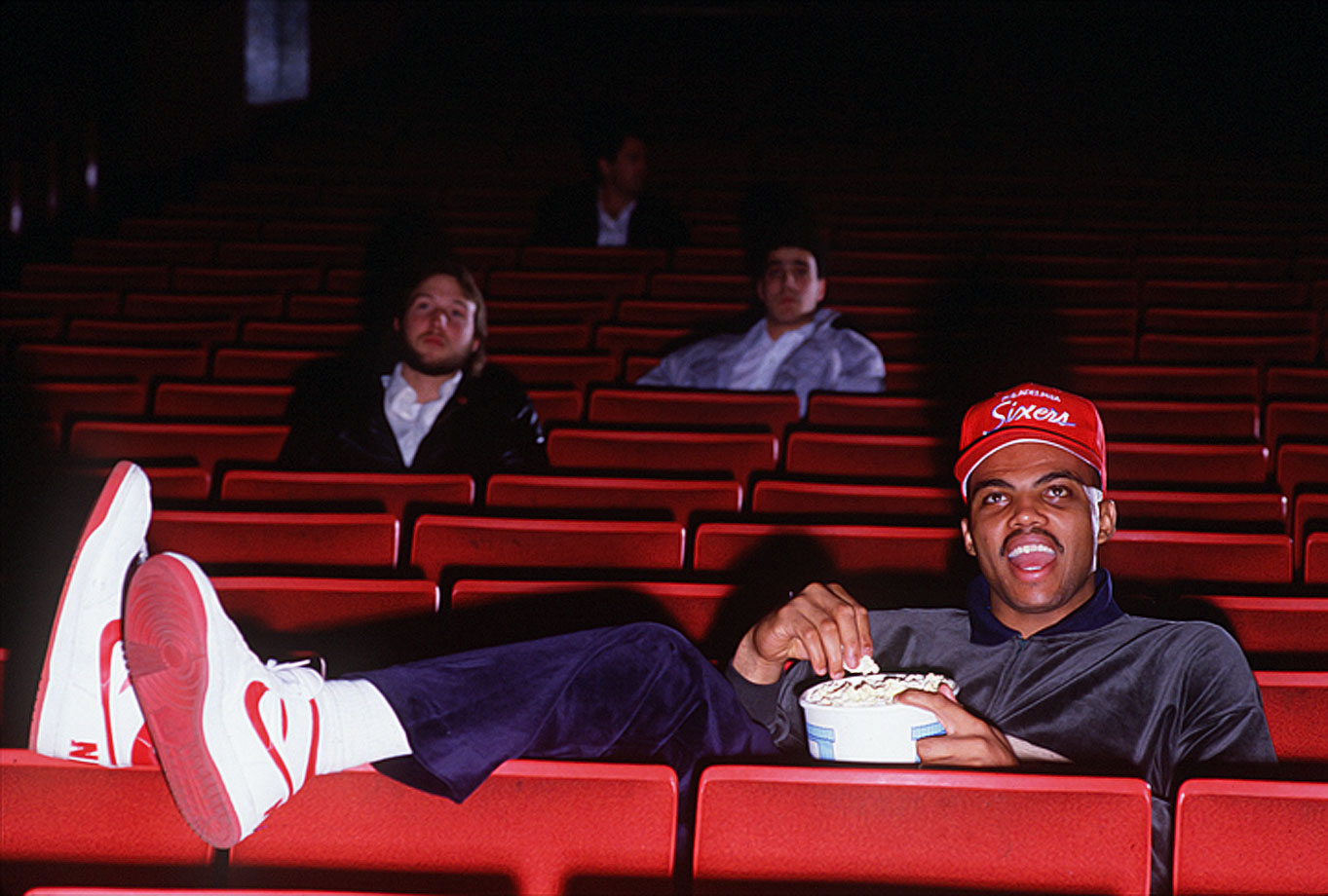 Charles Barkley's gregarious personality quickly made him a fan favorite. In this photo, the Alabama native takes in a movie at a Philadelphia theater.
