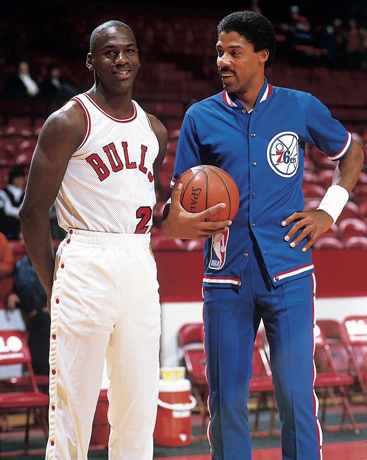 Michael Jordans smiles alongside Julius Erving during warmups before the Chicago Bulls game against the Philadelphia 76ers in November 1984.