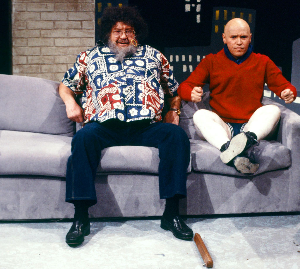 "Host Alex Karras, as Captain Lou Albano, and Billy Crystal, as Little Caesar, perform during the ""Tuesday Night Titans"" skit on Saturday Night Live on Feb. 2, 1985 in New York City."