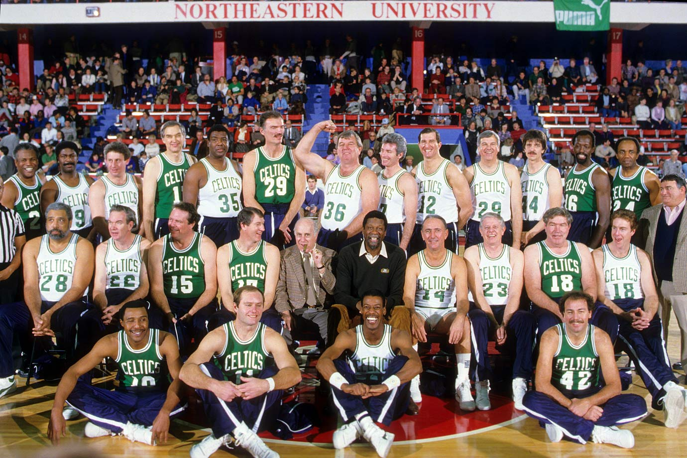 John Havlicek poses alongside Red Auerbach, Bill Russell, Bob Cousy other former Celtics during the Old Timers Night reunion at Matthews Arena on Northeastern University campus in Boston.