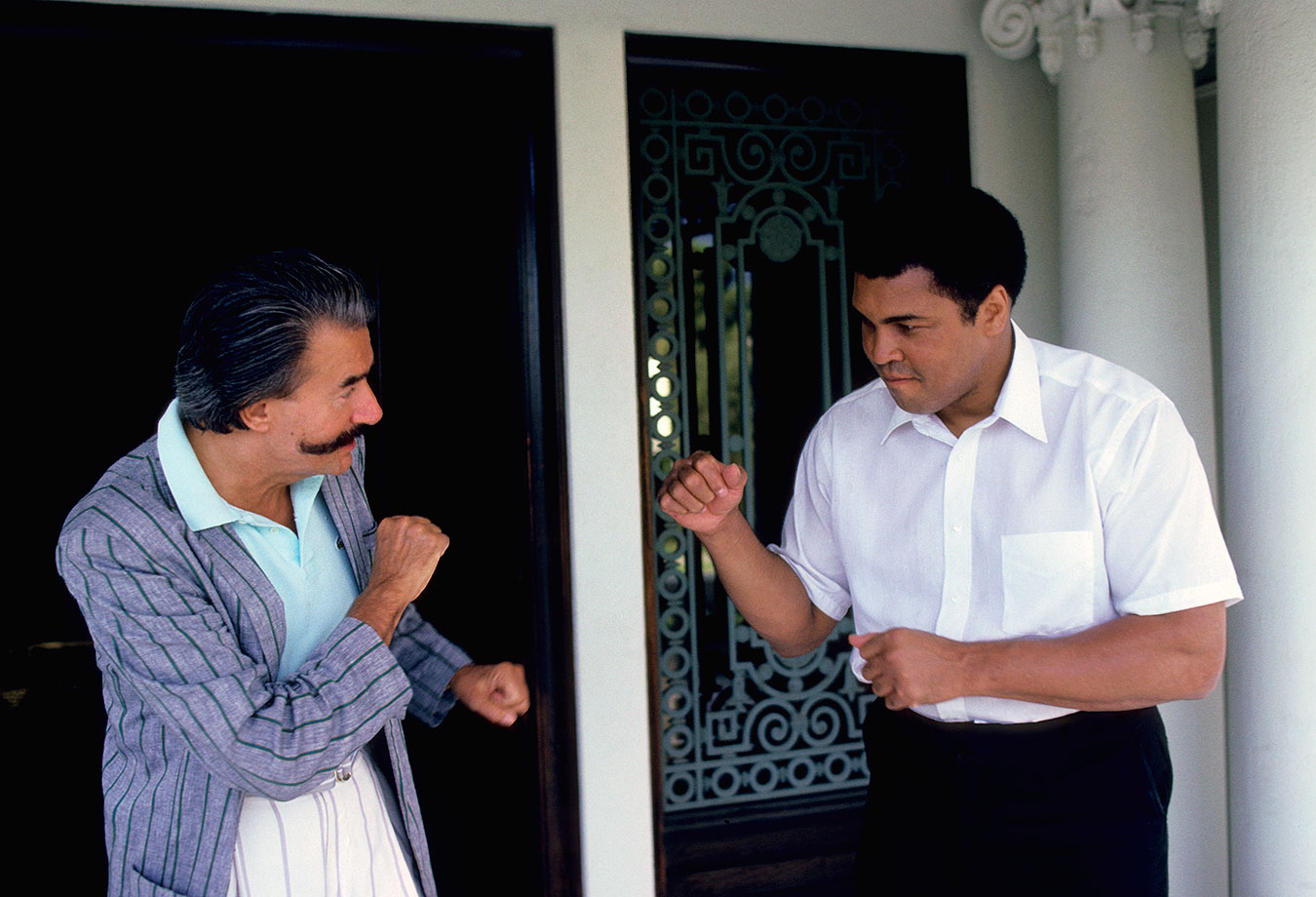 Ali pretends to spar with artist LeRoy Neiman at his home in Los Angeles. Neiman met Ali in 1962 and made many paintings and sketches from throughout Ali's life.