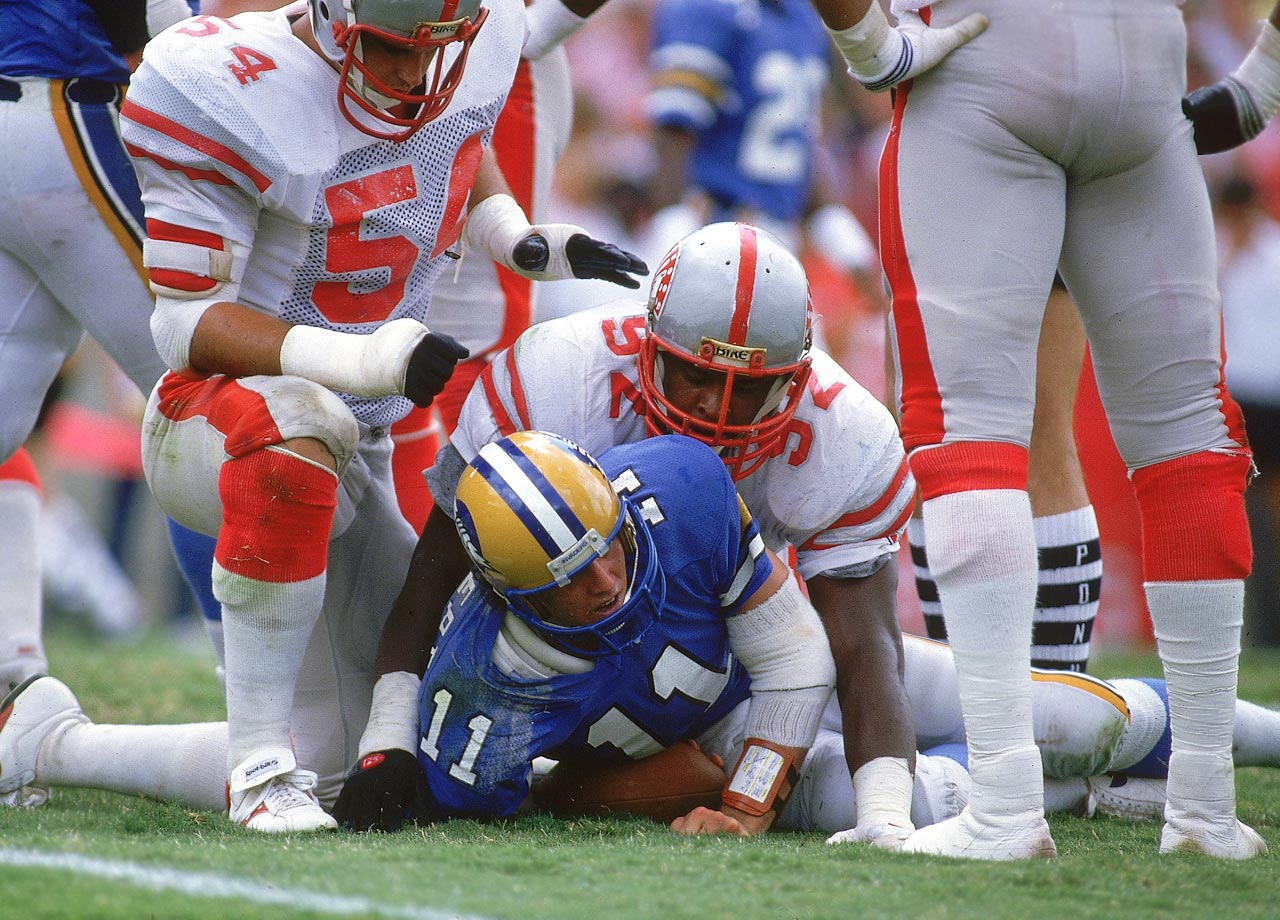 Memphis Showboats DE Reggie White sacks Oakland Invaders QB Bobby Herbert during the USFL playoffs on July 6, 1985 in Memphis, Tenn.