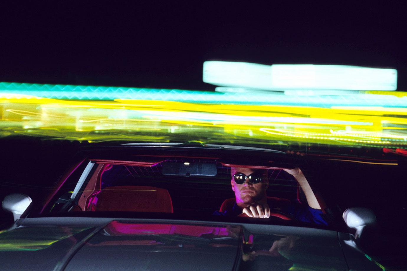 The Boz poses in his car in Norman, Okla.