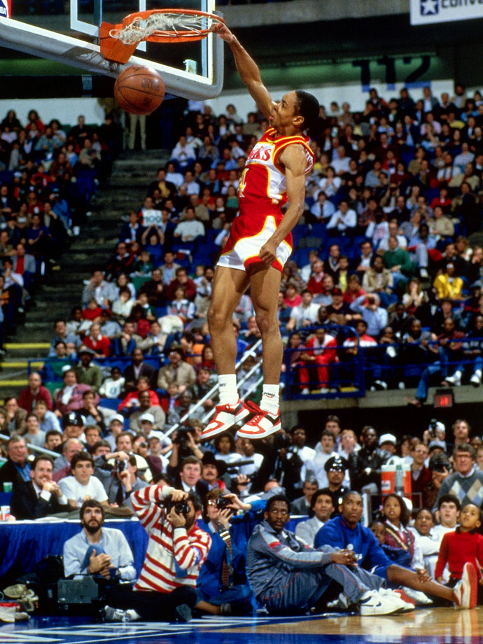 Delighting his hometown crowd, the 5-foot-6 guard scored perfect 50s on both of his dunks in the finals to edge Hawks teammate and defending champion Dominique Wilkins. Michael Jordan was injured and did not participate.