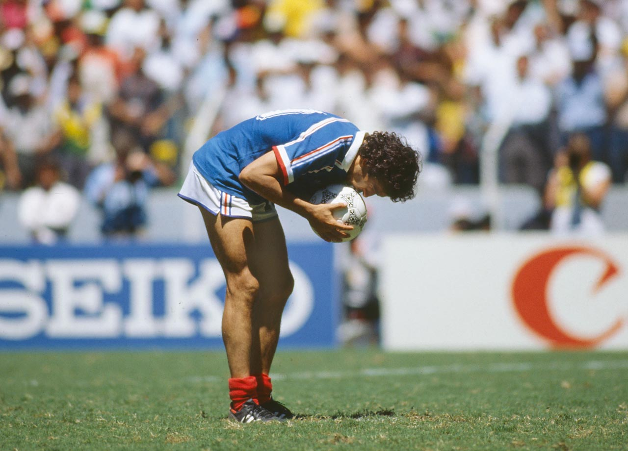 Michel Platini kisses the ball before missing a penalty in France's quarterfinal against Brazil in the 1986 World Cup.