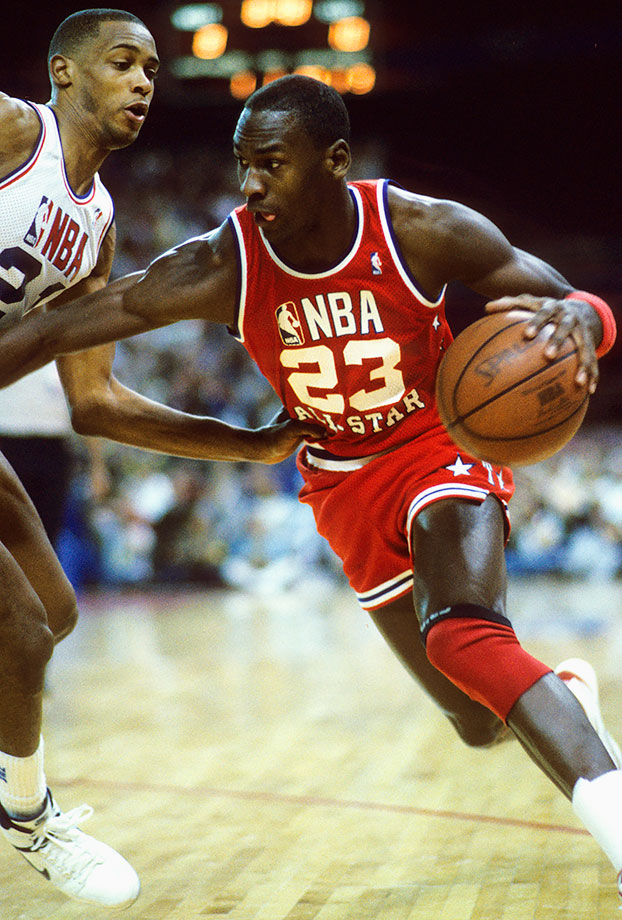 Michael Jordan drives with the ball in the 1987 All-Star Game. He earned his third straight All-Star selection and became the only player other than Wilt Chamberlain to score 3,000 points in a season. He also became the first player to record 200 steals and 100 blocks in a season.