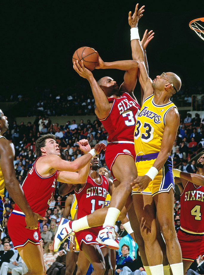 Charles Barkley shoots against Kareem Abdul-Jabbar during a Sixers-Lakers game in Los Angeles Lakers.
