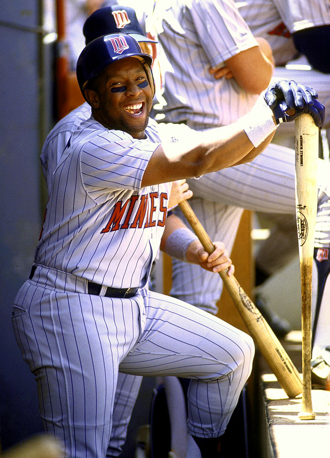 Kirby Puckett laughes in the Twins' dugout during a game against the Mariners.