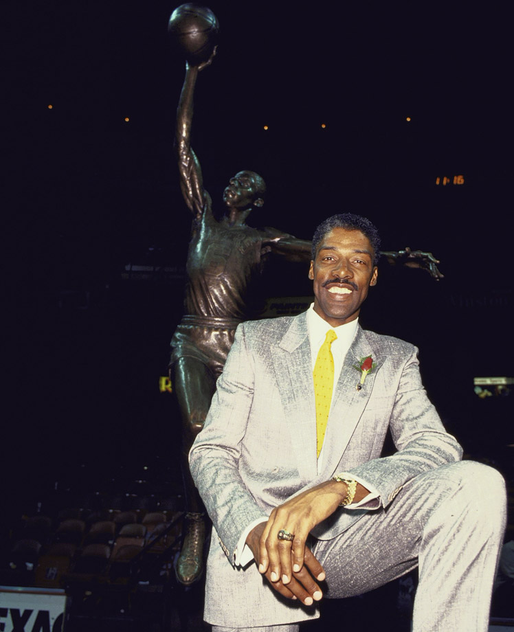 Dr J. poses in front of his statue during the unveiling ceremony at The Spectrum in 1988.