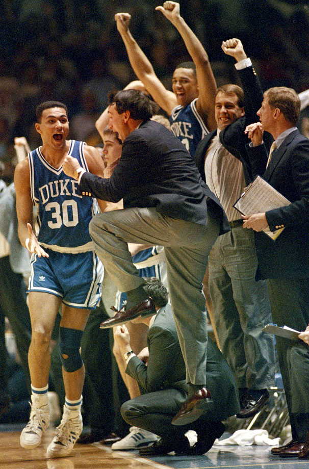 Mike Krzyzewski jumps in celebration after his Blue Devils beat North Carolina, 65-61, to win the 1988 ACC tournament championship. The rivalry between the two universities is considered one of the most intense rivalries in all of sports.