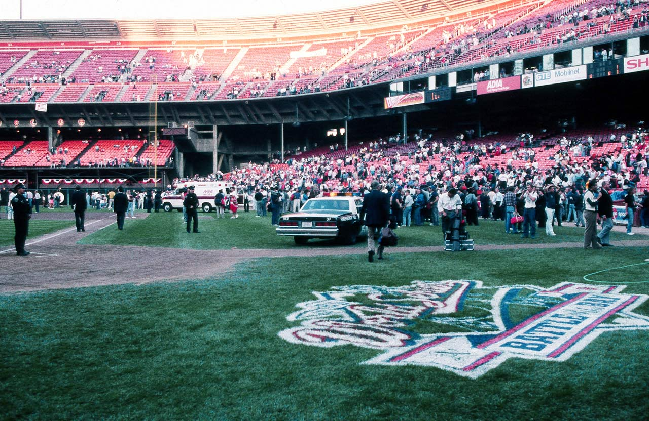 Police and emergency personnel occupy the field at Candlestick Park.