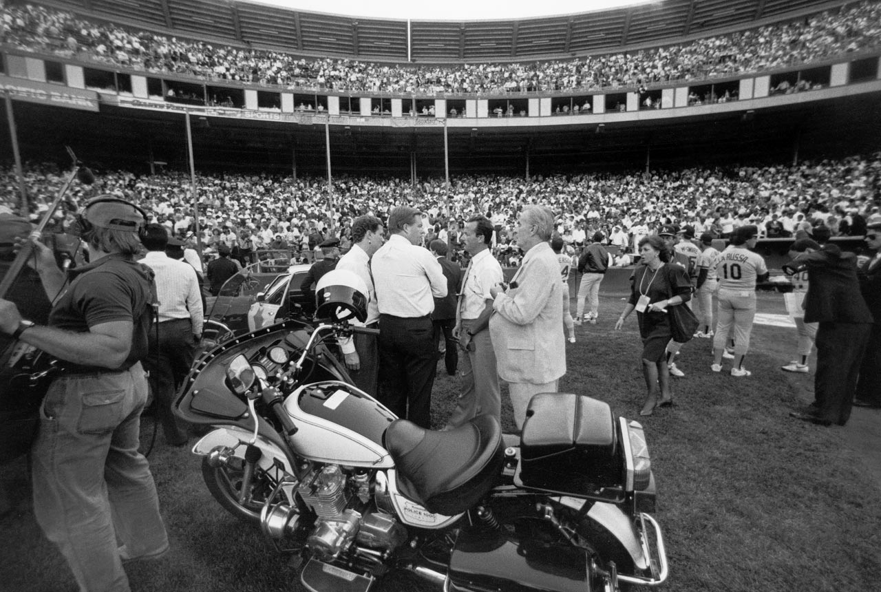 Officials stand on the field at Candlestick Park after the earthquake.