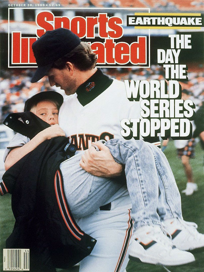 Kelly Downs of the San Franciso Giants carries his 11-year-old nephew, Billy Kehl, after the 6.9-magnitude Loma Prieta earthquake struck the Bay Area, postponing Game 3 of the World Series at Candlestick Park.