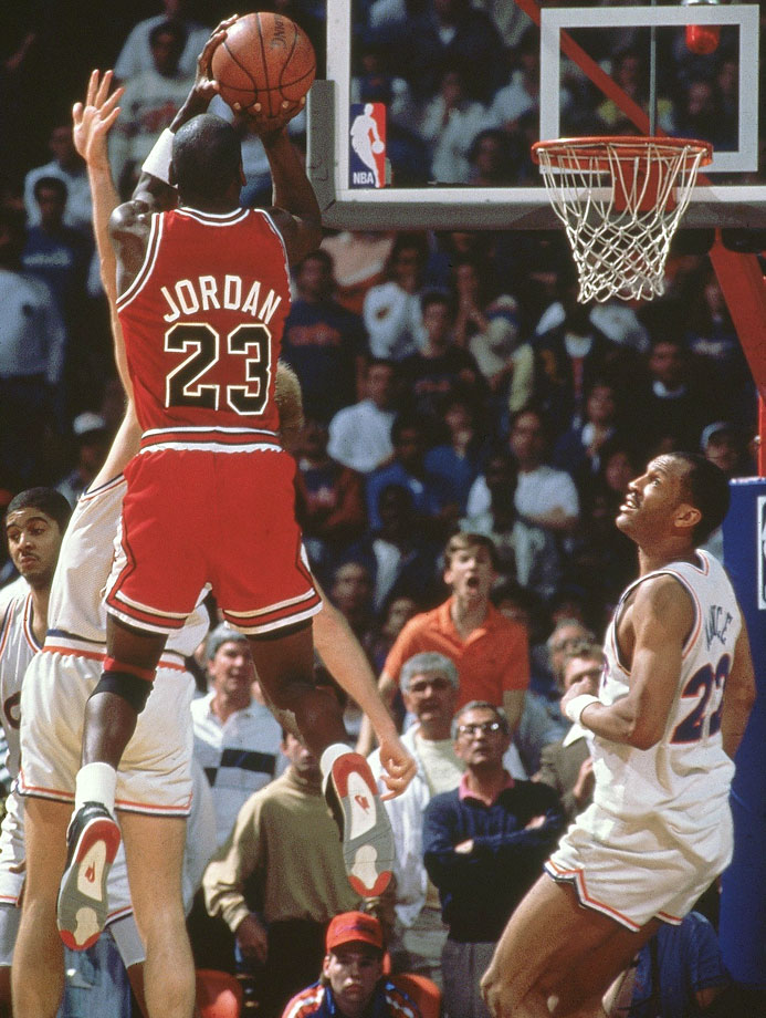 "Michael Jordan rises up for a buzzer-beater, now referred to as ""The Shot,"" to defeat the Cleveland Cavaliers in the playoffs on May 7, 1989. Jordan hit a jumper with six seconds remaining to give the Bulls a lead, only for the Cavaliers to take it right back with a layup by Craig Ehlo with three seconds left. Jordan, double-teamed on the inbounds play, got just enough separation to receive the ball and get the shot off over Ehlo to win the first-round series in five games."
