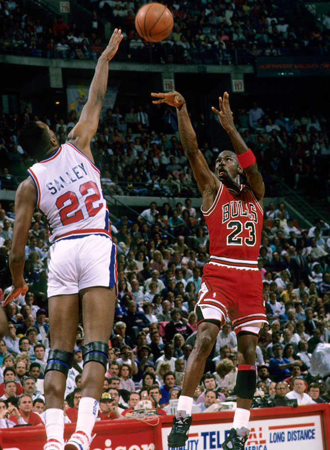 Michael Jordan puts up a shot over the outstretched arm of Detroit's John Salley in Game 2 of the 1990 Eastern Conference Finals. Despite four games with 31 or more points, Jordan was unable to keep the Pistons from eliminating the Bulls in the conference finals for the second consecutive season.