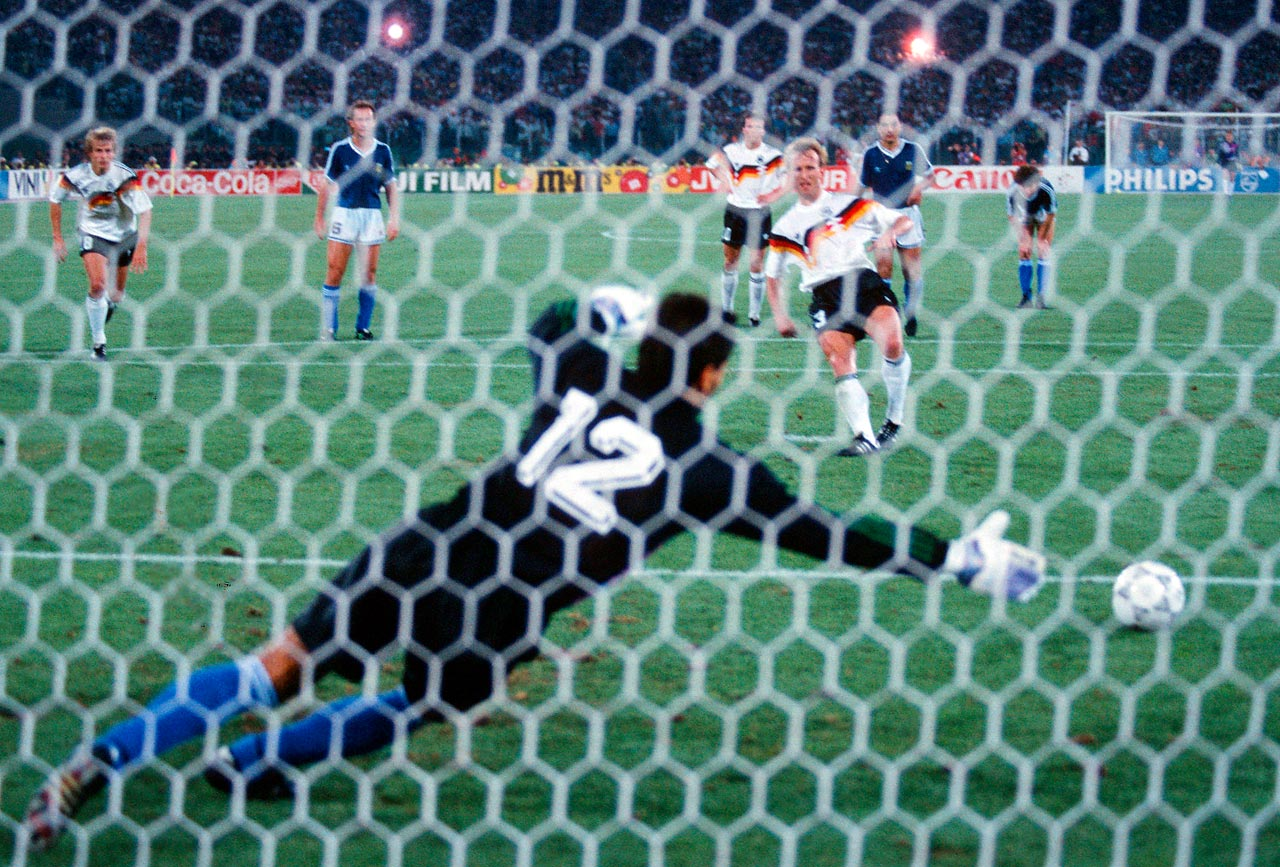 Andreas Brehme of West Germany scores the only goal in the 1990 World Cup final between his country and Argentina.