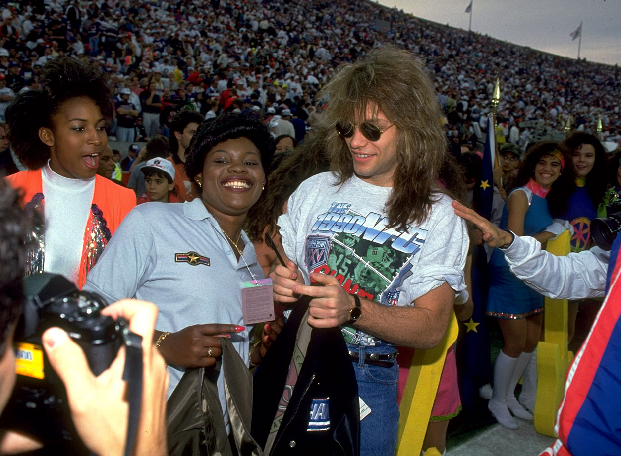 Jon Bon Jovi signs some autographs for fans on the sidelines before Super Bowl XXV between the New York Giants and Buffalo Bills in Tampa, Fla.