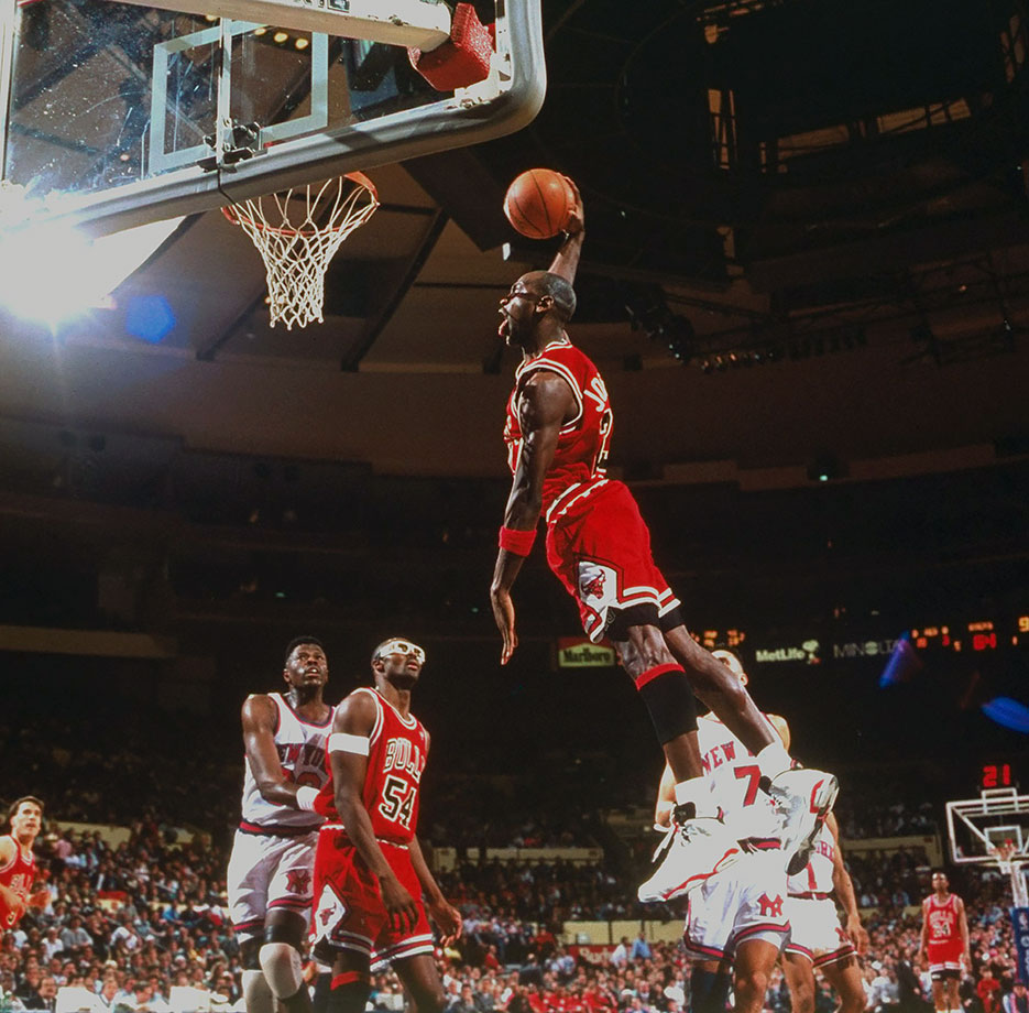 Michael Jordan soars for a slam against the Knicks in April 1991. He scored 34 points with eight rebounds, four assists and three steals in the Bulls' win in New York.