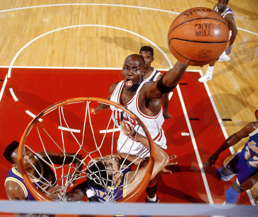 Michael Jordan goes up for a one-handed slam in 1991. He averaged 31.5 points per game in the 1990-91 season, part of a seven-season stretch in which he scored more than 30 points per game.