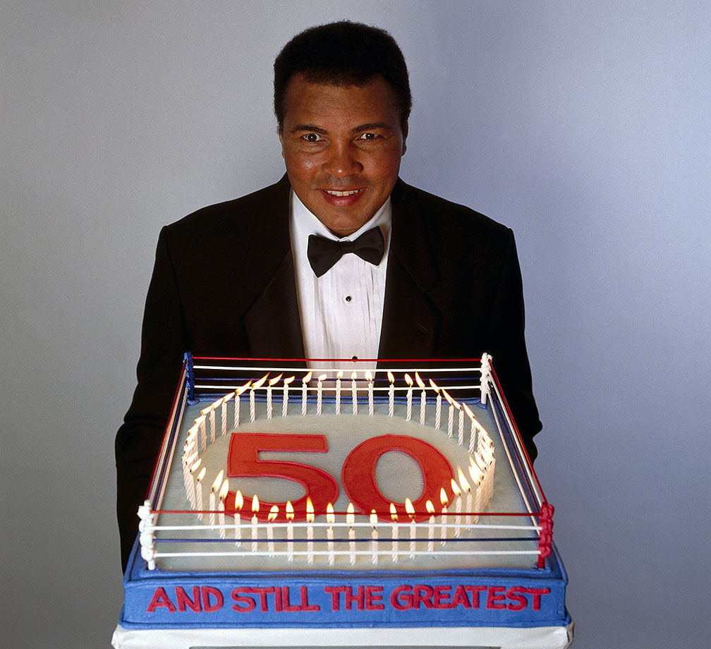 Cake in hand, Ali poses for a 50th birthday portrait in 1991. Although diagnosed with Parkinson's syndrome seven years earlier, Ali was still active, traveling to Iraq during the Gulf War to meet with Saddam Hussein in an attempt to negotiate the release of American hostages.