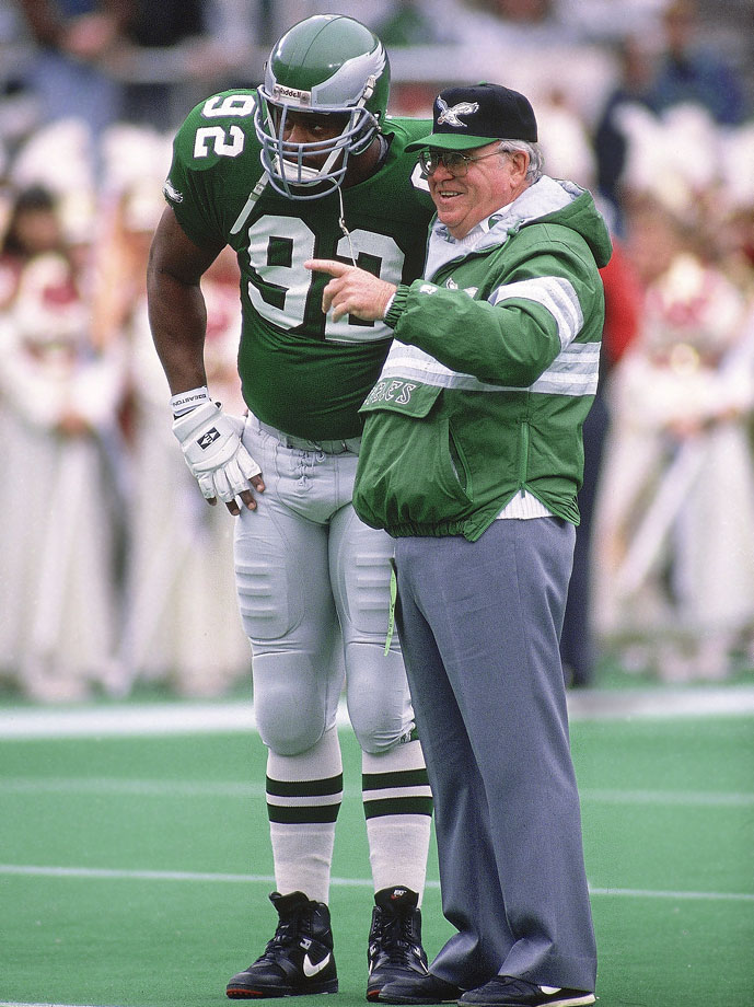Philadelphia Eagles DE Reggie White talks with head coach Buddy Ryan before their NFC playoffs playoff game against the Washington Redskins on Jan. 5, 1991 in Philadelphia.